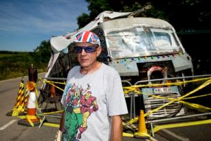 Gypsy Neil Wainwright beside his mobile home on the side of the road near Hayle